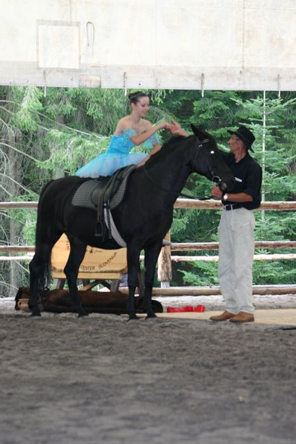 Andrej Znidarsic lead Nika Lipota into the arena on horseback to perform her ballet. Nika has been a returning student to Kaja & Grom Ranch summer programs for many years.