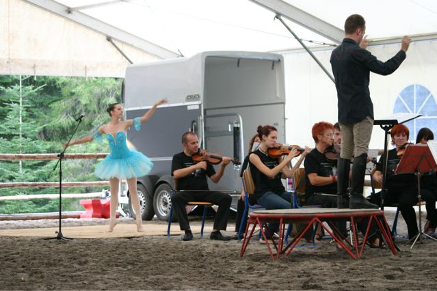 Nika performs for the Opening of the new Kaja & Grom Ranch and TTEAM/Animal Ambassador Center. I love this photo with the horse trailer from one of the ranch sponsors of the background. What a small world. this trailer in Slovenia is manufactured by Buchmann, a German family I have known for 30 years.