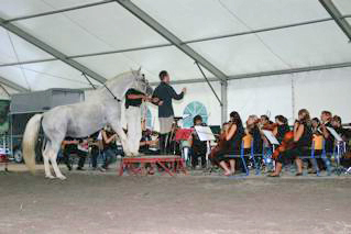 Simon Dvorsak conducting the Symphony Orchestra Domzale-Kamnik in the arena on the opening day