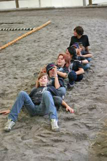 The teenagers relaxing after helping to prepare the arena for the event!