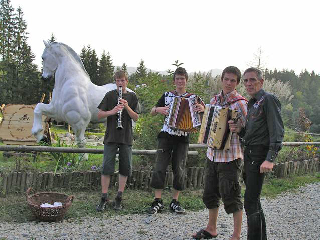 Andrej (right) with local musicians who enterained the guests who were enjoying a traditional slovenian dinner prepared by Darja's mother.
