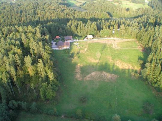 Kaja & Grom Ranch from the air. The road leading in and out of the property is a charming winding gravel road.