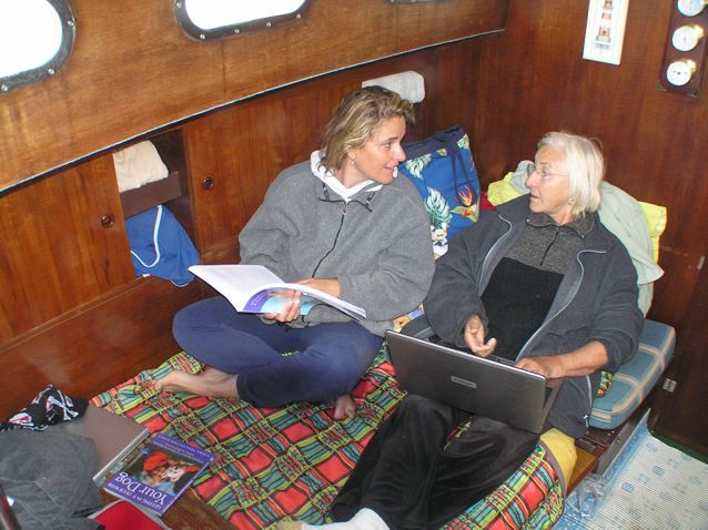 "Darja & Linda below deck. Darja is reading my new book, TTouch for Healthcare and I'm writing this journal on my trusty comupter named ""Spirit."""