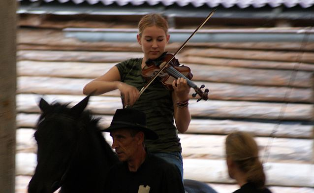 Kaja & Grom/TTouch student Nika Goldnik entertains the 100 plus guests as she is led into the arena to join the orchestra.