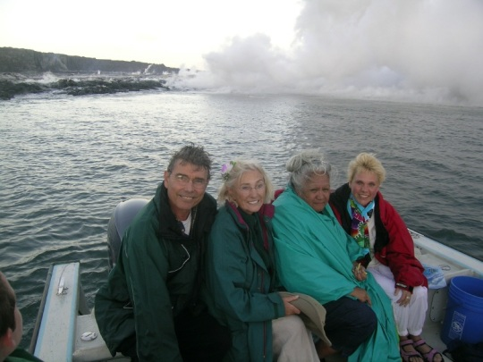 Roland Kleger, Linda Tellington-Jones, Aunty Mahealani Henry, and Karin Freiling on a boat ride where the volcano flows into the sea.