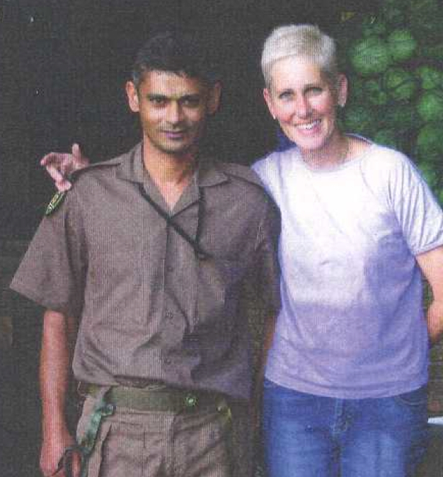 Rita Brock with Warden Solomon Malan, who helps with the feral cat program